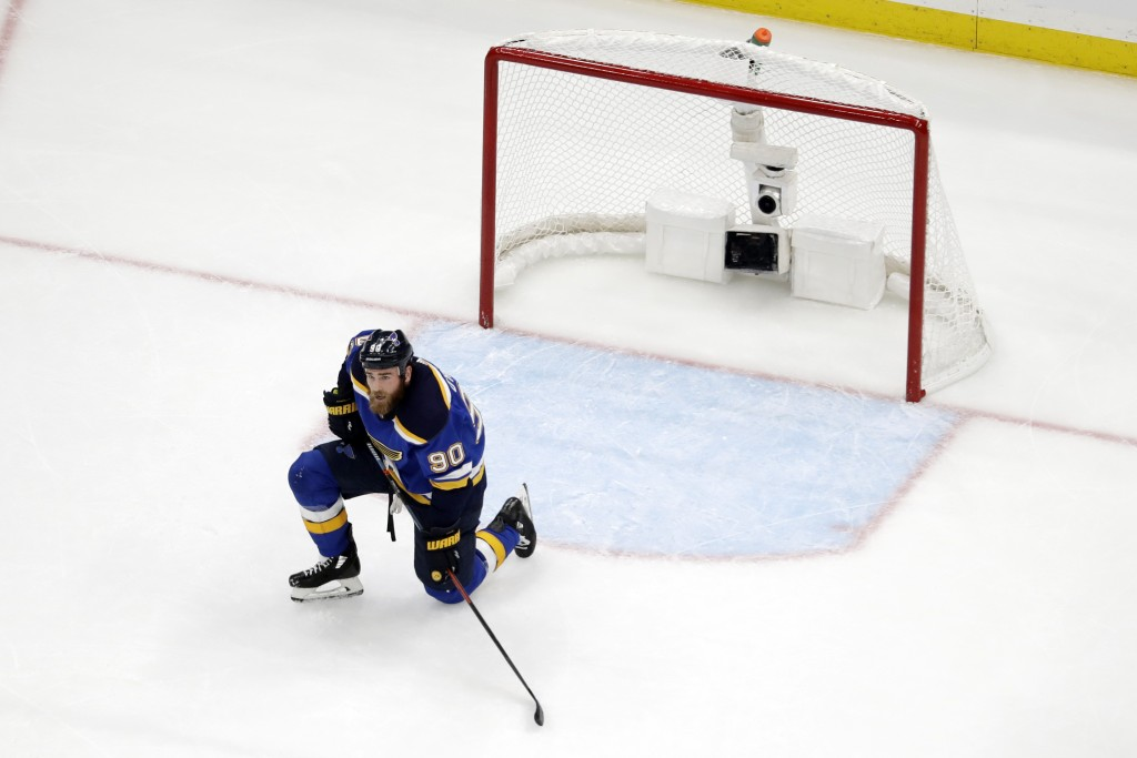 St. Louis Blues center Ryan O'Reilly (90) kneels by the net after the San Jose Sharks tied the game late in the third period of Game 3 of the NHL hock