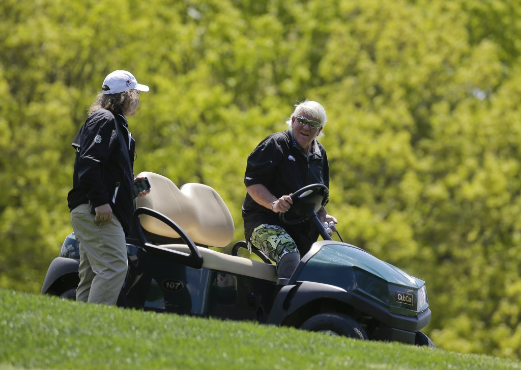 John Daly gets into a golf cart after teeing off on the fifth hole during a practice round for the PGA Championship golf tournament, Wednesday, May 15