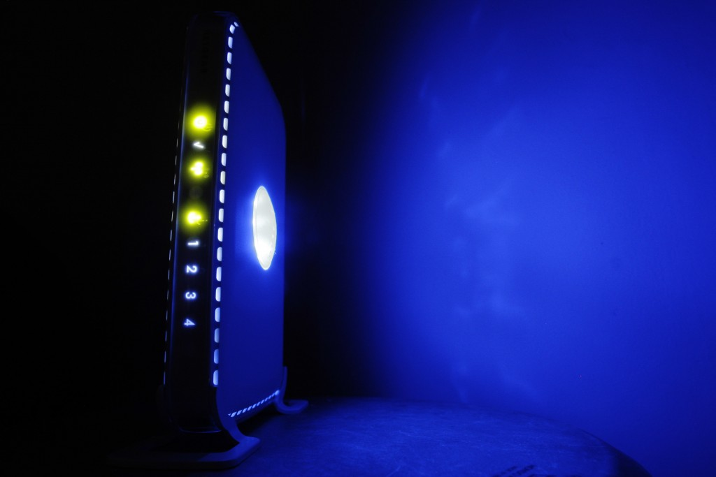 FILE- This July 27, 2008, file photo shows a, LED-illuminated wireless router in Philadelphia. Officials from the United States and Europe are announc...