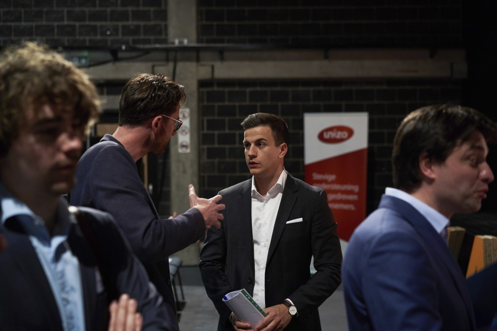 In this April 23, 2019 photo, Vlaams Belang party candidate Dries van Langenhove speaks with attendees at a debate with other party leaders in Zemst,