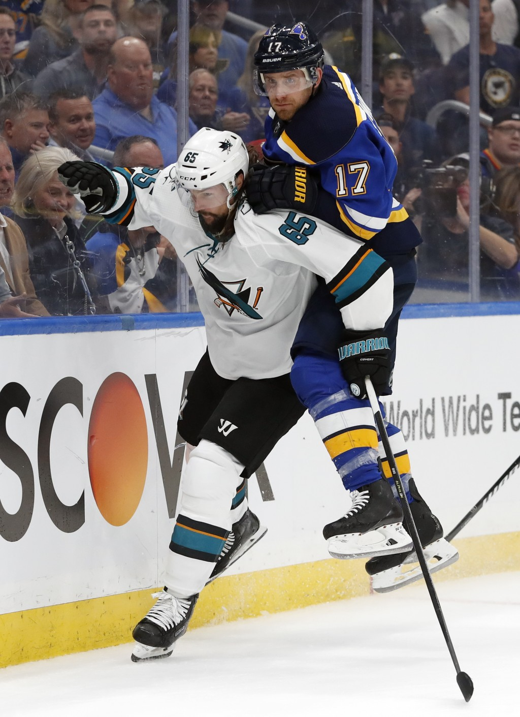 St. Louis Blues left wing Jaden Schwartz (17) lands on the back of San Jose Sharks defenseman Erik Karlsson (65), of Sweden, during the third period i