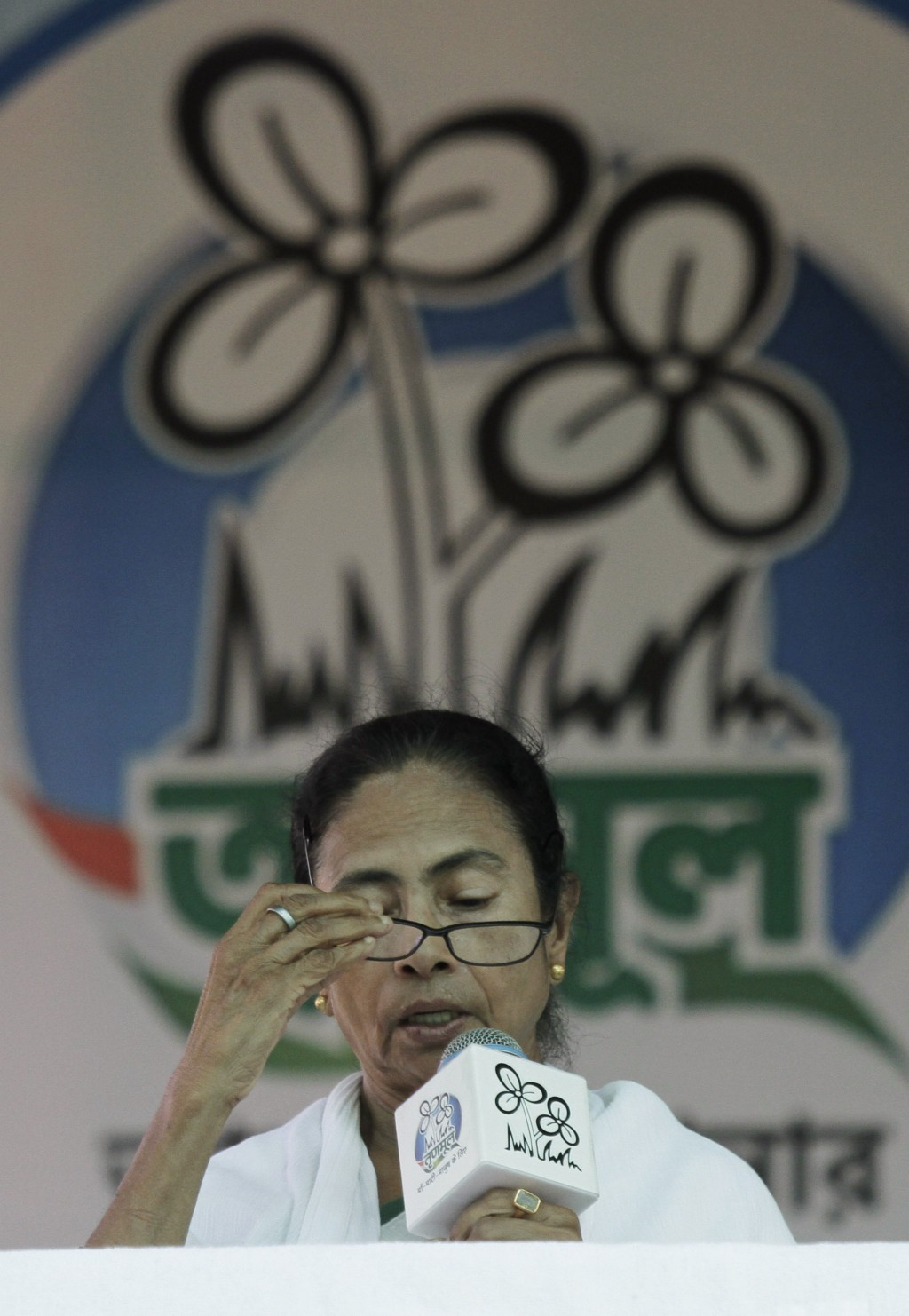 Trinamool Congress leader and Chief Minister of West Bengal state Mamata Banerjee speaks during an election rally at Anchana in Mathurapur, about 60 k