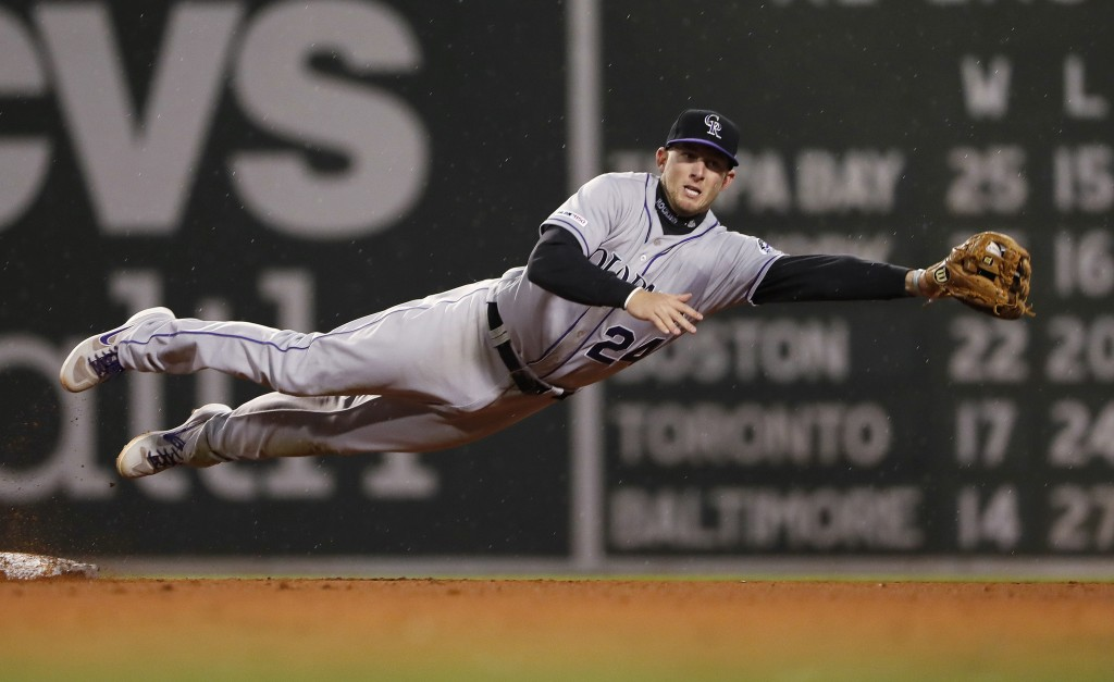Colorado Rockies' Ryan McMahon leaps to grab a wide throw on a steal of second base by Boston Red Sox's Christian Vazquez during the fifth inning of a