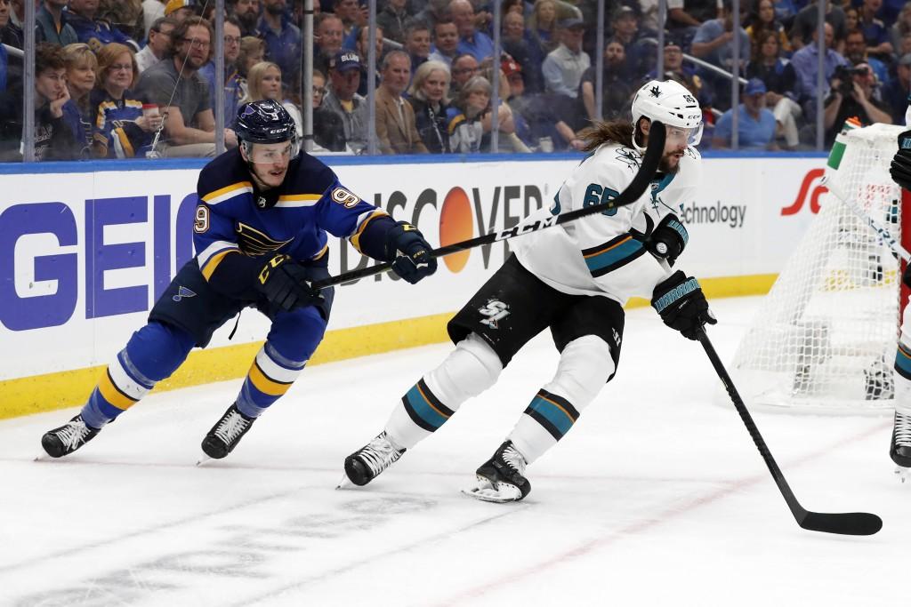 St. Louis Blues left wing Sammy Blais (9) tries to slow down San Jose Sharks defenseman Erik Karlsson (65), of Sweden, during the third period in Game