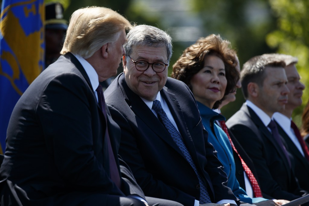 President Donald Trump talks with Attorney General William Barr during the 38th Annual National Peace Officers' Memorial Service at the U.S. Capitol,