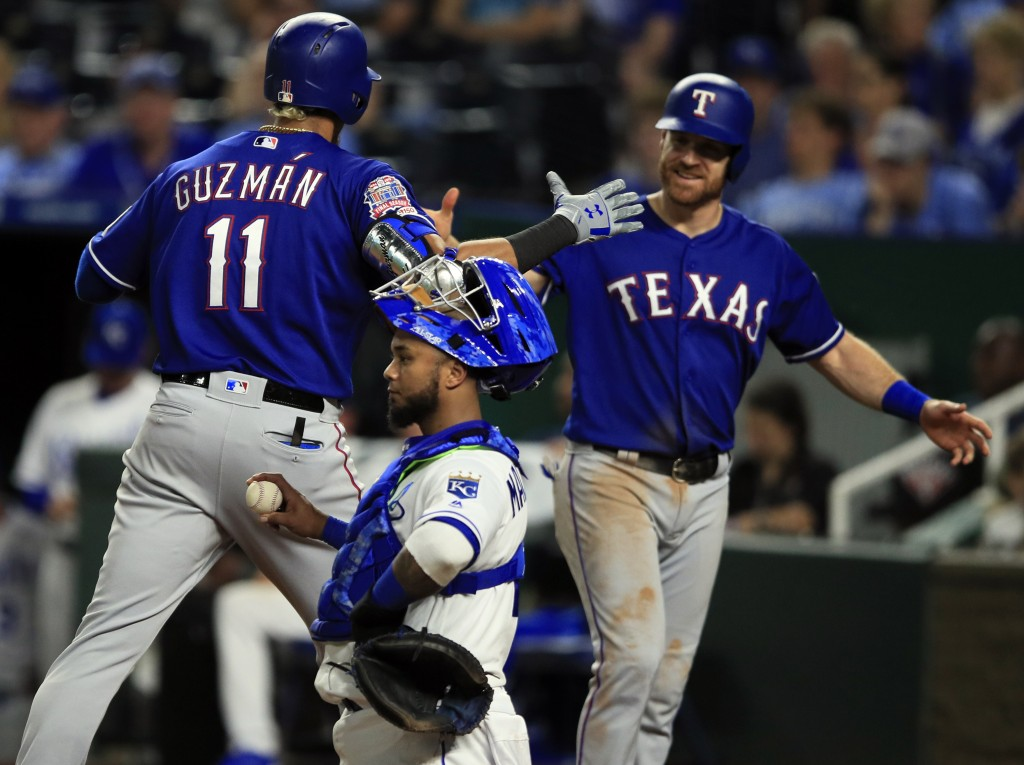 Texas Rangers' Ronald Guzman (11) celebrates his two-run home run with teammate Logan Forsythe, right, during the sixth inning of a baseball game agai