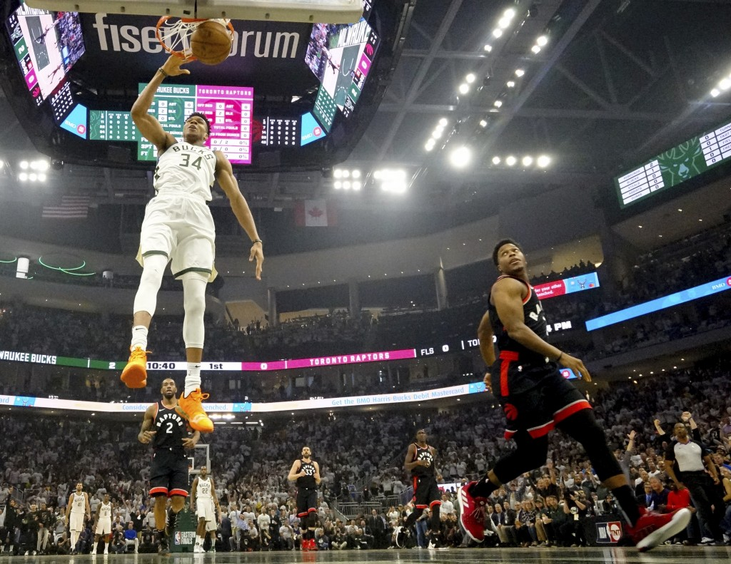 Milwaukee Bucks' Giannis Antetokounmpo dunks during the first half of Game 1 of the NBA Eastern Conference basketball playoff finals against the Toron...