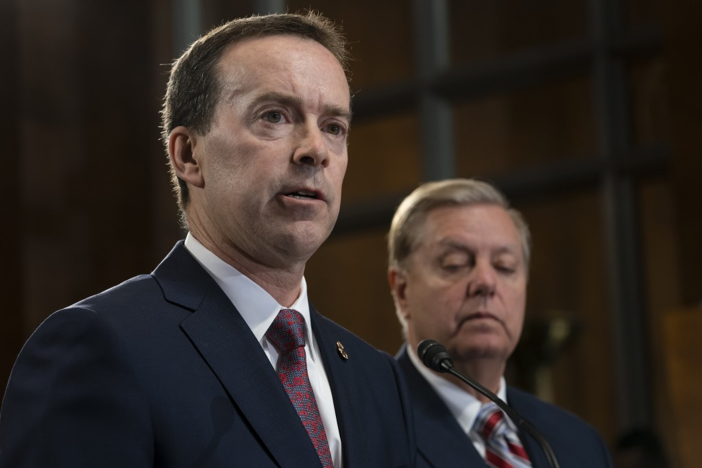Acting U.S. Customs and Border Protection Commissioner John Sanders, left, joins Senate Judiciary Committee Chairman Lindsey Graham, R-S.C., right, an