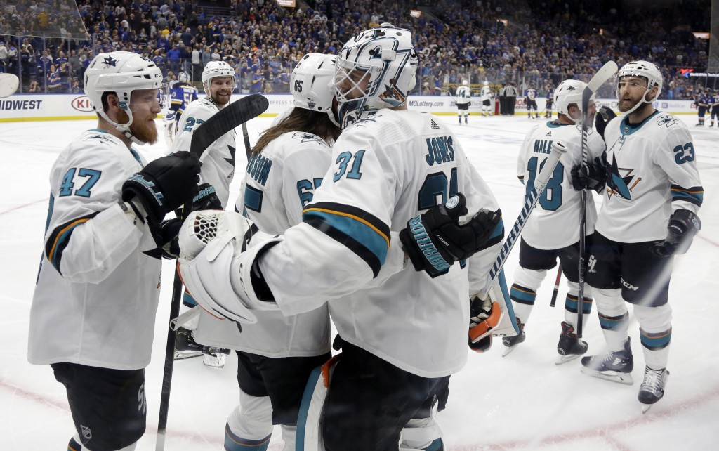 San Jose Sharks goaltender Martin Jones (31) celebrates with Joakim Ryan (47) and Erik Karlsson (65), of Sweden, after Karlsson scored the winning goa