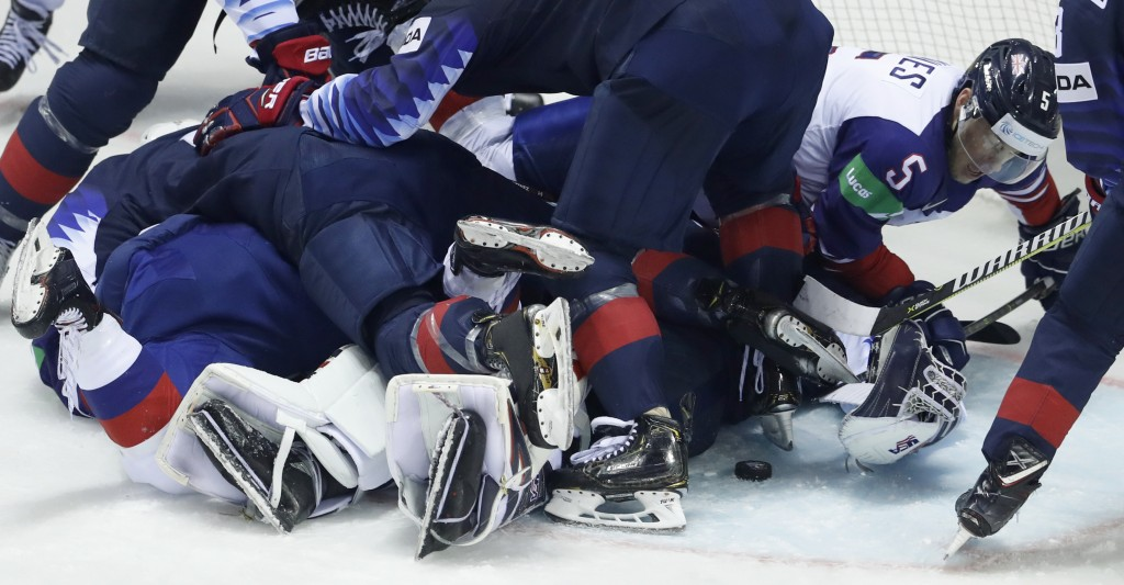 Great Britain's Ben Davies, right, reaches for the puck during the Ice Hockey World Championships group A match between the United States and Great Br