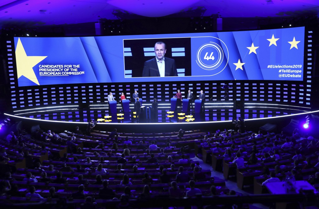 Germany's Manfred Weber of the European People's Party is shown on the large screen as he participates in a debate with other candidates to the presid
