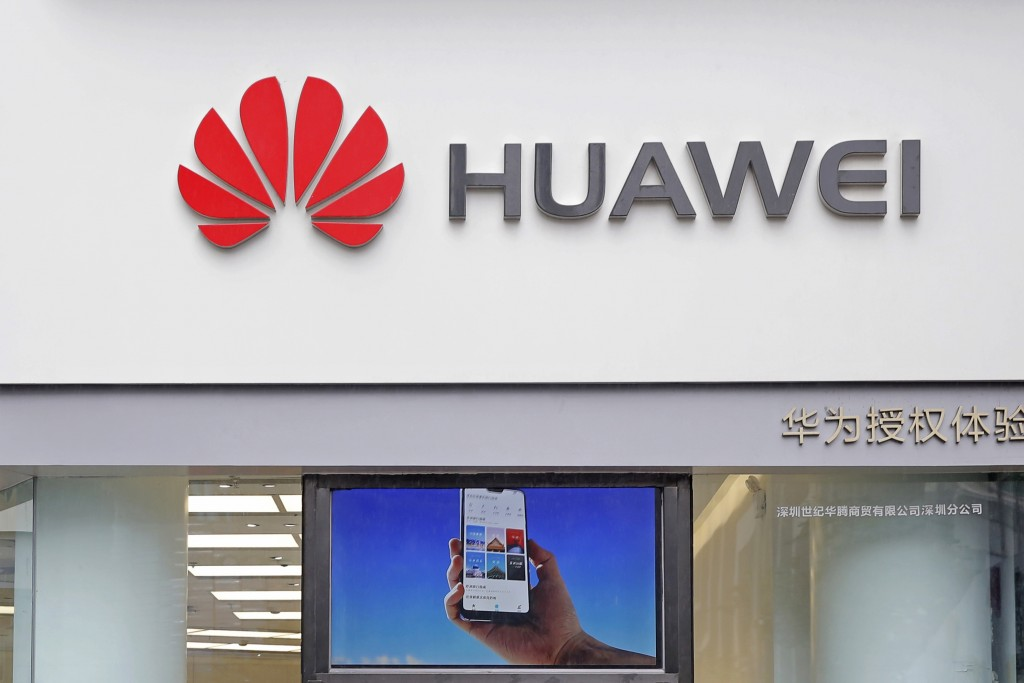 FILE - In this March 7, 2019 file photo, a logo of Huawei is displayed at a shop in Shenzhen, China's Guangdong province. President Donald Trump issue...