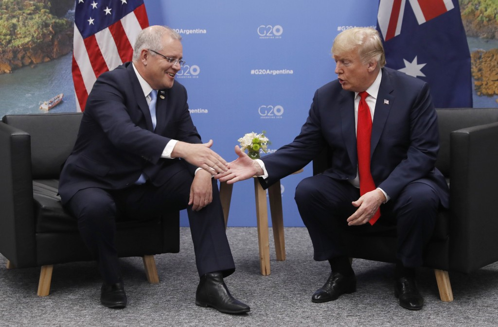 FILE - In this Nov. 30, 2018, file photo, Australian Prime Minister Scott Morrison, left, meets with U.S. President Donald Trump at the G20 in Buenos