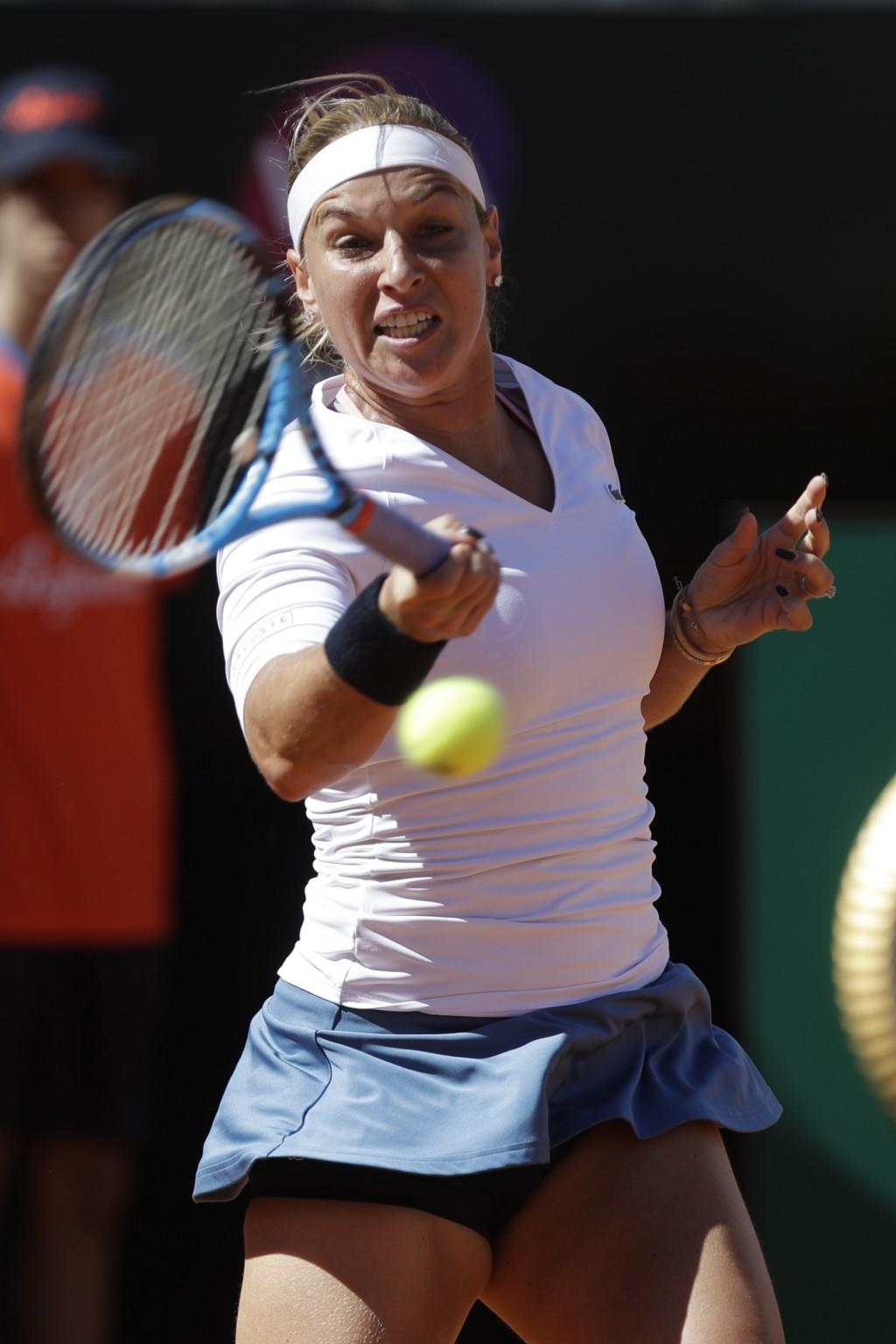 Slovakia's Dominika Cibulkova returns the ball during her match against Japan's Naomi Osaka at the Italian Open tennis tournament, in Rome, Thursday,