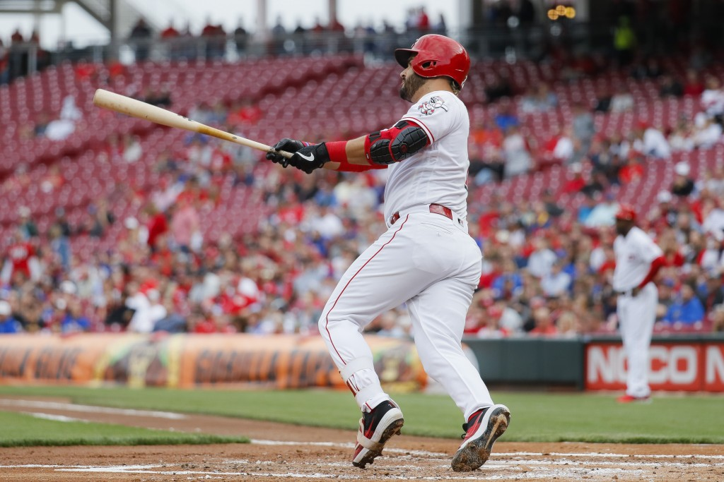Cincinnati Reds' Eugenio Suarez hits an RBI double off Chicago Cubs starting pitcher Yu Darvish in the first inning of a baseball game, Wednesday, May