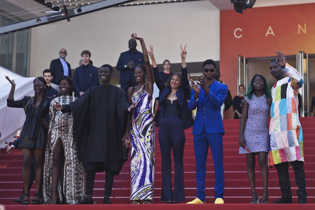 Writer director Mati Diop, fifth from left, poses with cast and crew upon arrival at the premiere of the film 'Atlantique' at the 72nd international f