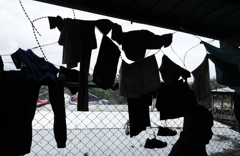 In this May 10, 2019 photo, migrant's clothes are hung on barbed wire to dry at a shelter in Peñitas, Darien Province, Panama. The International Organ