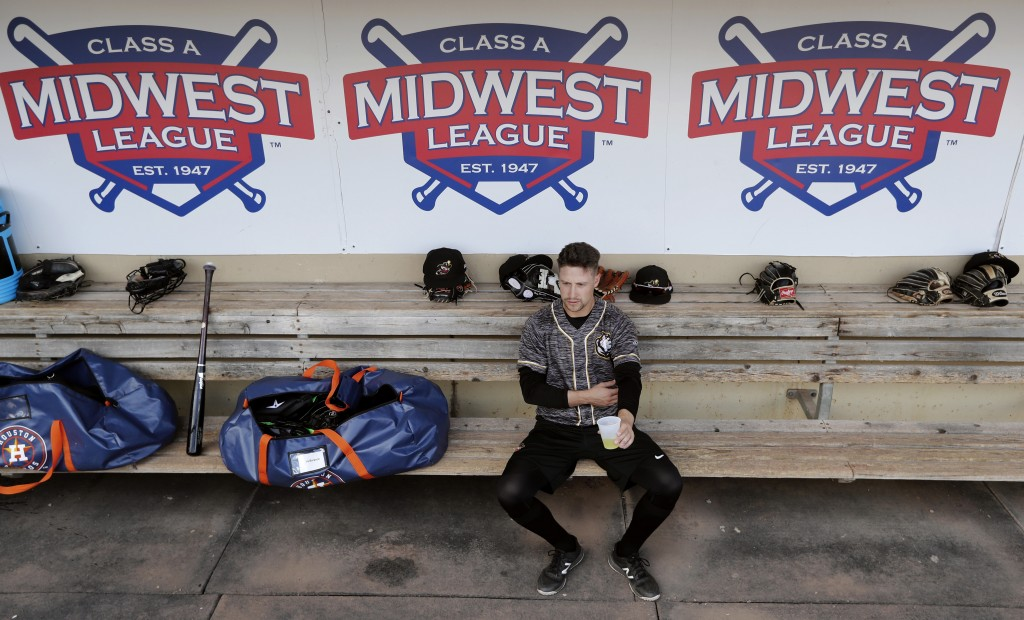 In this Monday, May 13, 2019 photo, Quad Cities River Bandits infielder Trey Dawson sits in the dugout before a Class-A Midwest League baseball game a