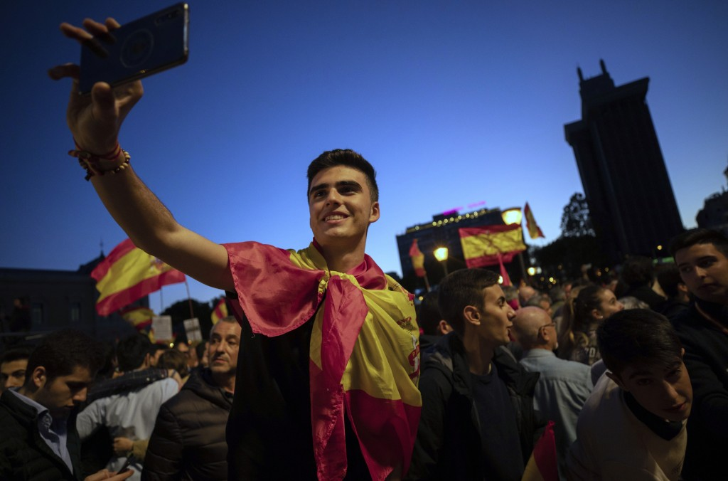 FILE - In this Friday, April 26, 2019 file photo, far-right Vox party supporters attend an election campaign event in Madrid, Spain. In Spain, Vox's g
