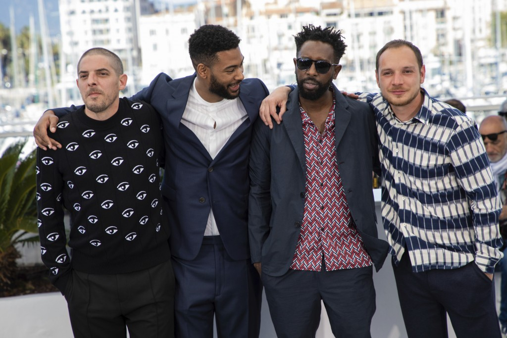 Actors Damien Bonnard, from left, Djebril Zonga, director Ladj Ly and actor Alexis Manenti pose for photographers at the photo call for the film 'Les