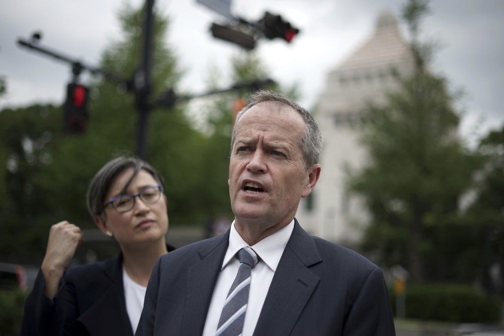 FILE - In this Sept. 27, 2017, file photo, Australian opposition leader Bill Shorten speaks to journalists, accompanied by Sen. Penny Wong, left, in f...