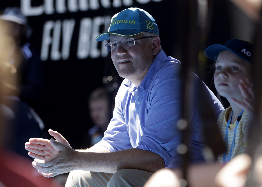 FILE - In this Jan 20, 2019, file photo, Australian Prime Minister Scott Morrison watches the fourth round match between Australia's Ashleigh Barty an