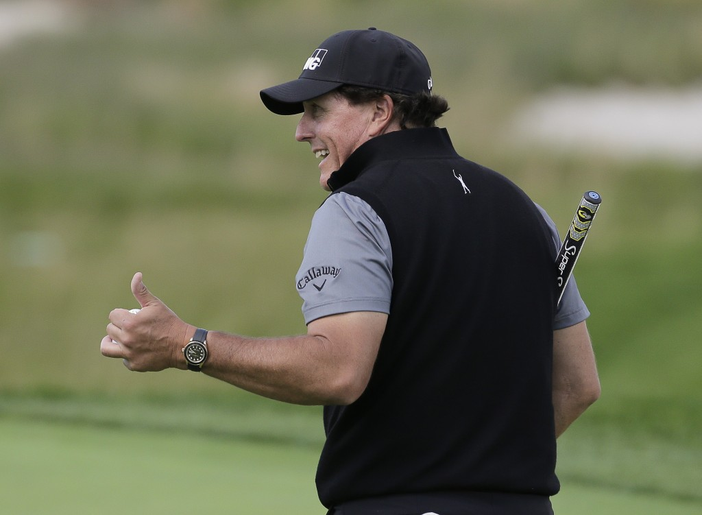Phil Mickelson motions to fans during a practice round for the PGA Championship golf tournament, Wednesday, May 15, 2019, at Bethpage Black in Farming