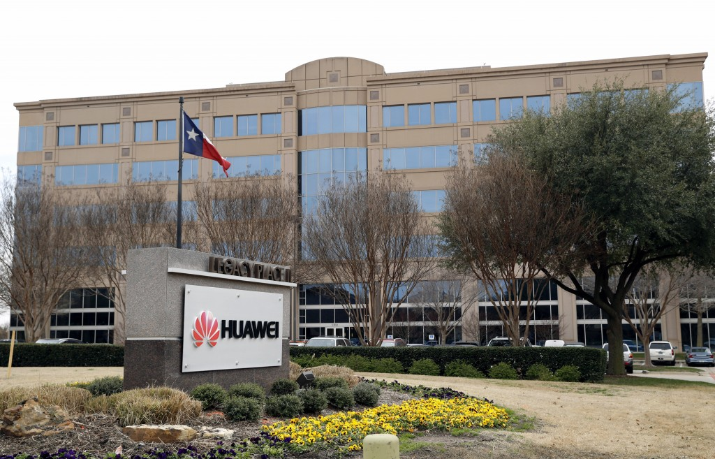 FILE - In this Thursday, March 7, 2019 file photo, the Texas state flag files outside the Huawei Technologies Ltd. business location in Plano, Texas. ...