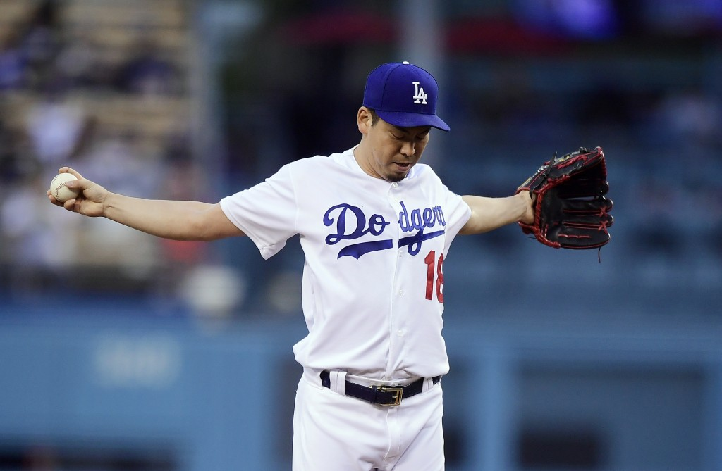 Los Angeles Dodgers starting pitcher Kenta Maeda, of Japan, gets set to pitch during the first inning of a baseball game against the San Diego Padres