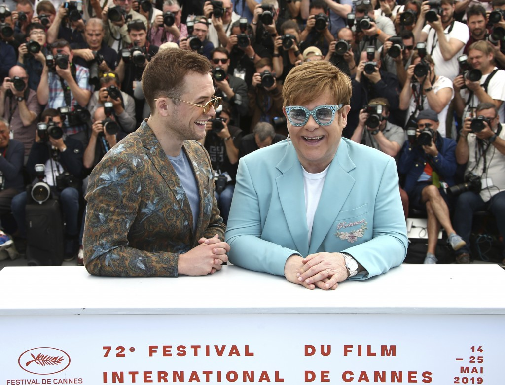 Actor Taron Egerton, left, and singer Elton John pose for photographers at the photo call for the film 'Rocketman' at the 72nd international film fest