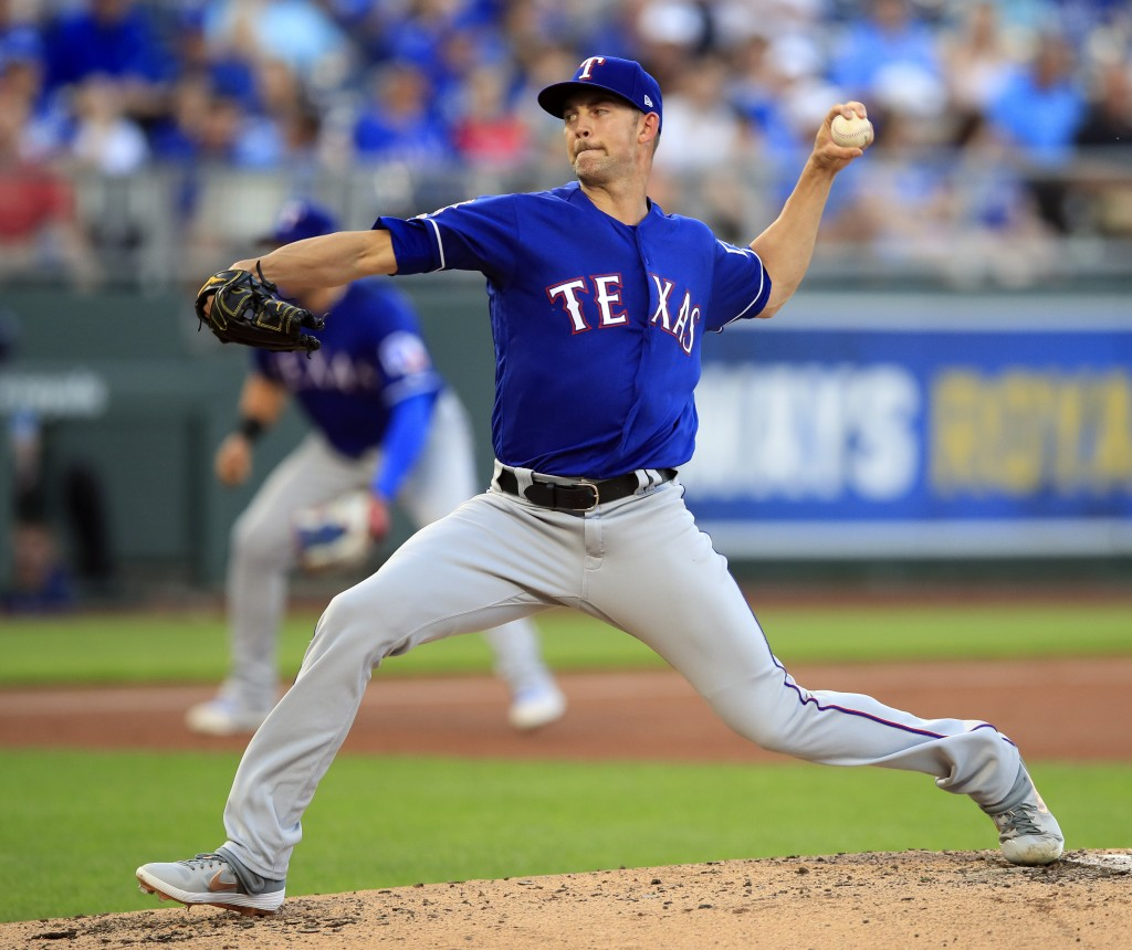 Texas Rangers starting pitcher Mike Minor delivers to a Kansas City Royals batter during the first inning of a baseball game at Kauffman Stadium in Ka