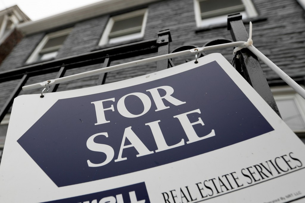 FILE - In this Jan. 4, 2019, photo a sign is displayed outside a house for sale in Pittsburgh's Lawrenceville neighborhood. On Thursday, May 16, Fredd...