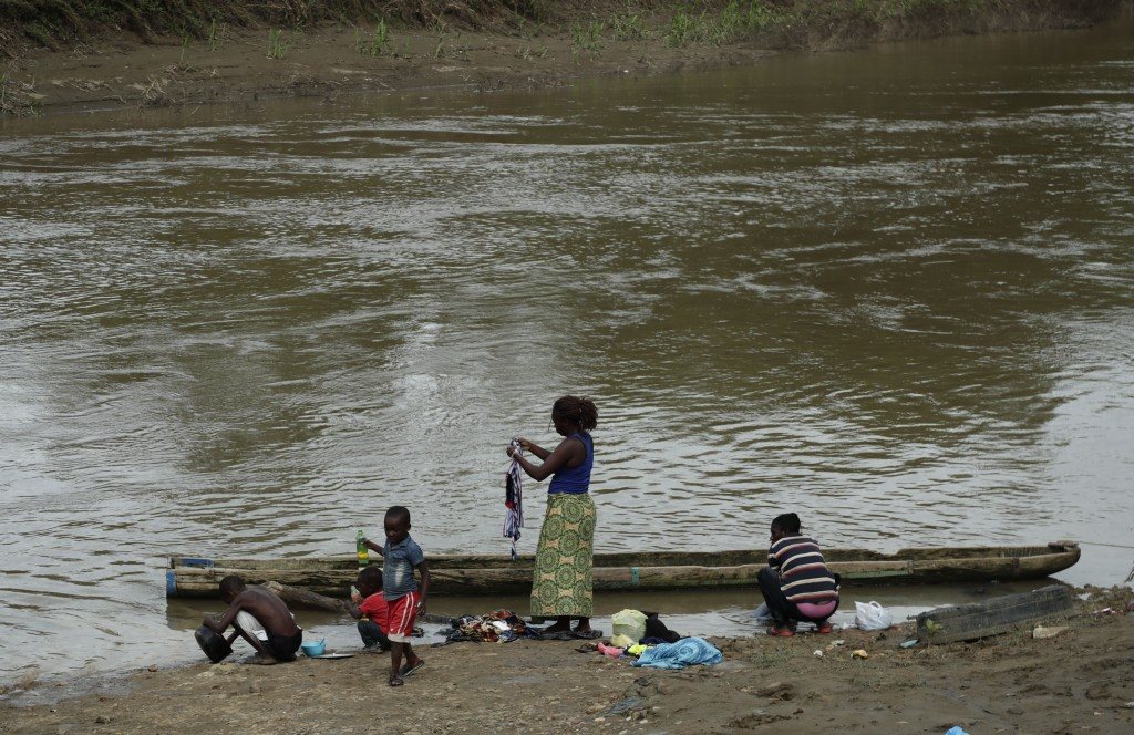 In this May 10, 2019, migrants wash their clothes on the Chucunaque river in Peñitas, Darien Province, Panama. Emerging from the Gap, most migrants pa
