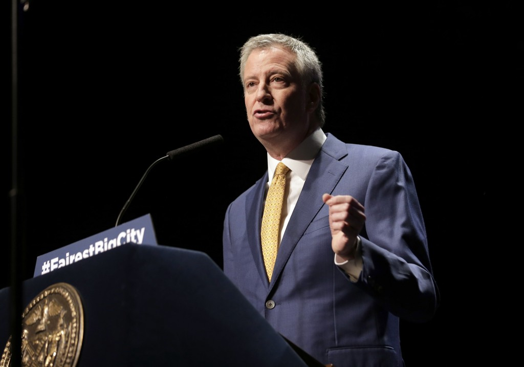 FILE - In this Jan 10, 2019, file photo, New York City Mayor Bill de Blasio speaks at his State of the City address in New York.  De Blasio announced