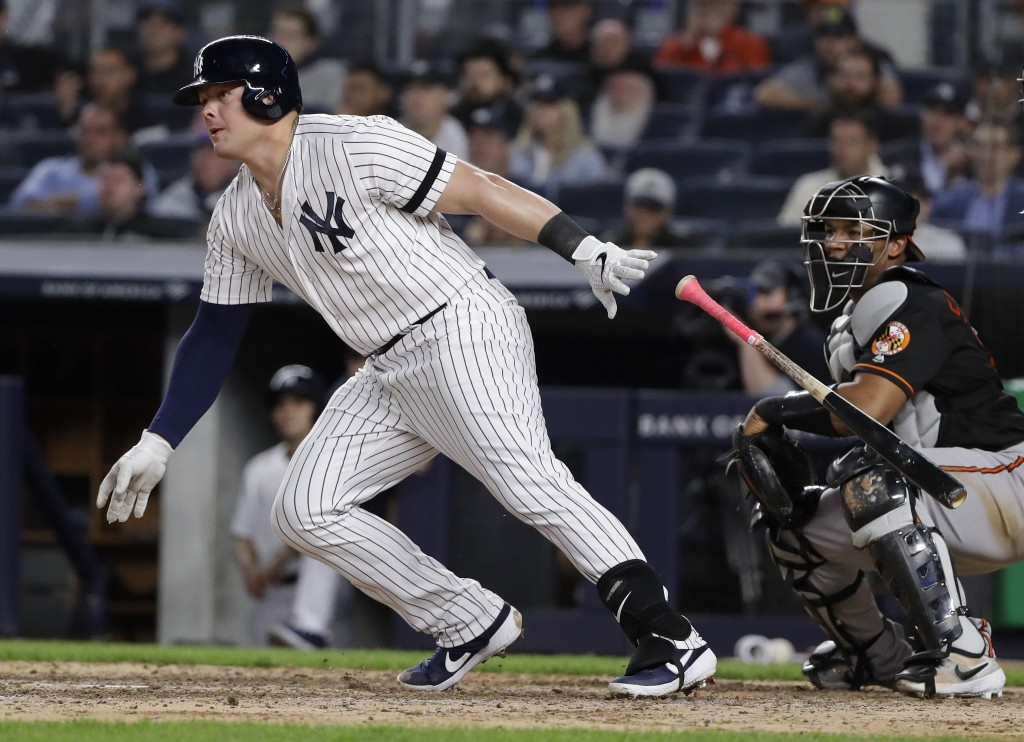 New York Yankees' Luke Voit follows through on a RBI single during the seventh inning of the second baseball game of the team's doubleheader against t