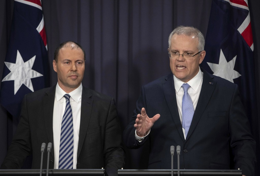 FILE - In this Aug. 24, 2018, file photo, Australia's next Prime Minister Scott Morrison, right, speaks next to Deputy Leader of the Liberal Party Jos