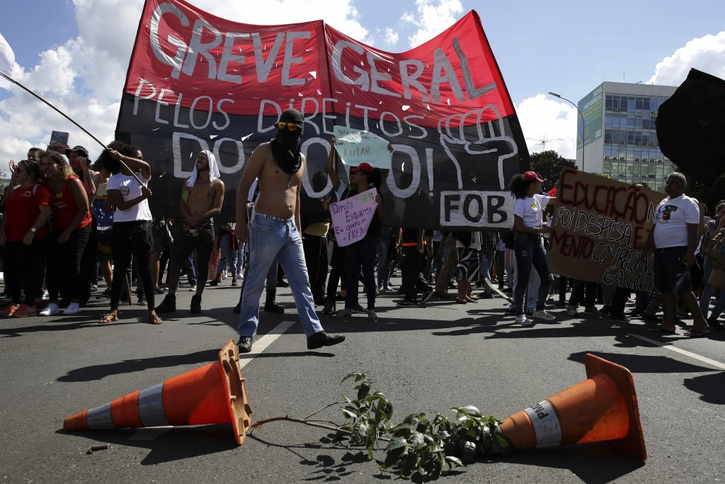 Demonstrators set up a barricade during nation-wide education strike, in Brasilia, Brazil, Wednesday, May 15, 2019. Federal education officials this m