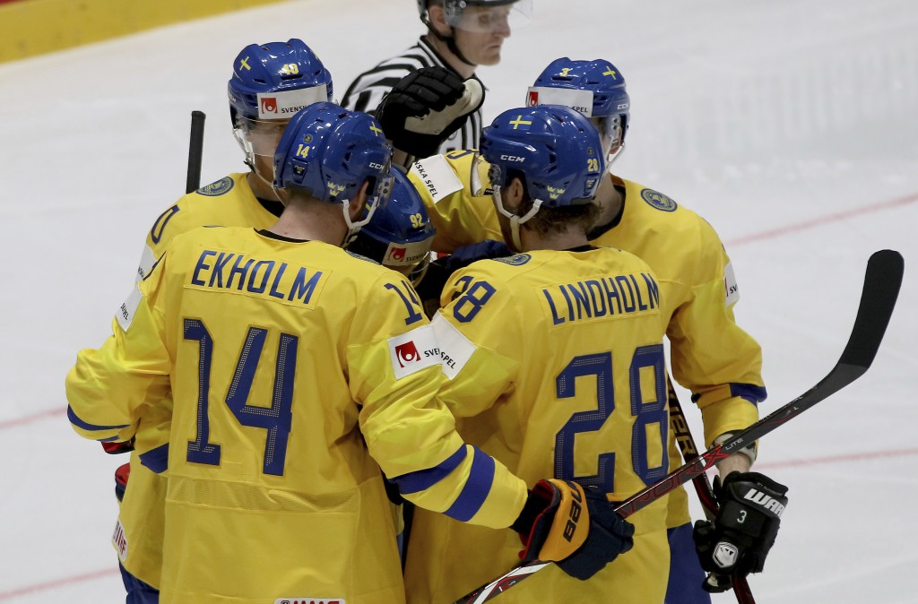 Sweden's players react after scoring during the Ice Hockey World Championships group B match between Sweden and Austria at the Ondrej Nepela Arena in ...