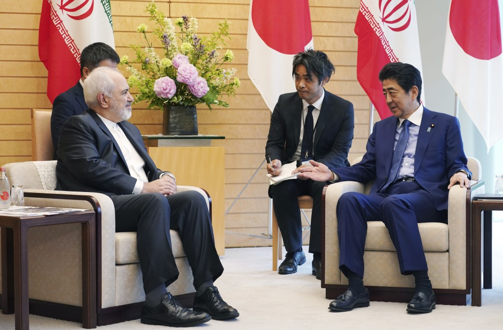 Iranian Foreign Minister Mohammad Javad Zarif, left, and Japanese Prime Minister Shinzo Abe, right, speak at Abe's official residence in Tokyo Thursda