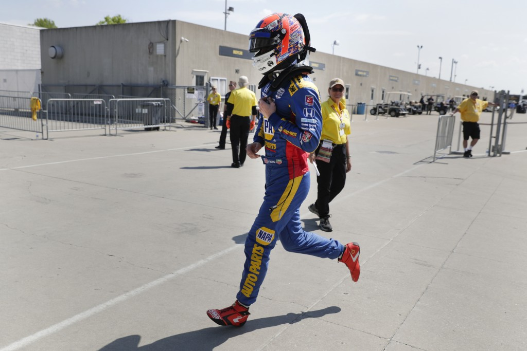 Alexander Rossi runs to the pit area during practice for the Indianapolis 500 IndyCar auto race at Indianapolis Motor Speedway, Wednesday, May 15, 201