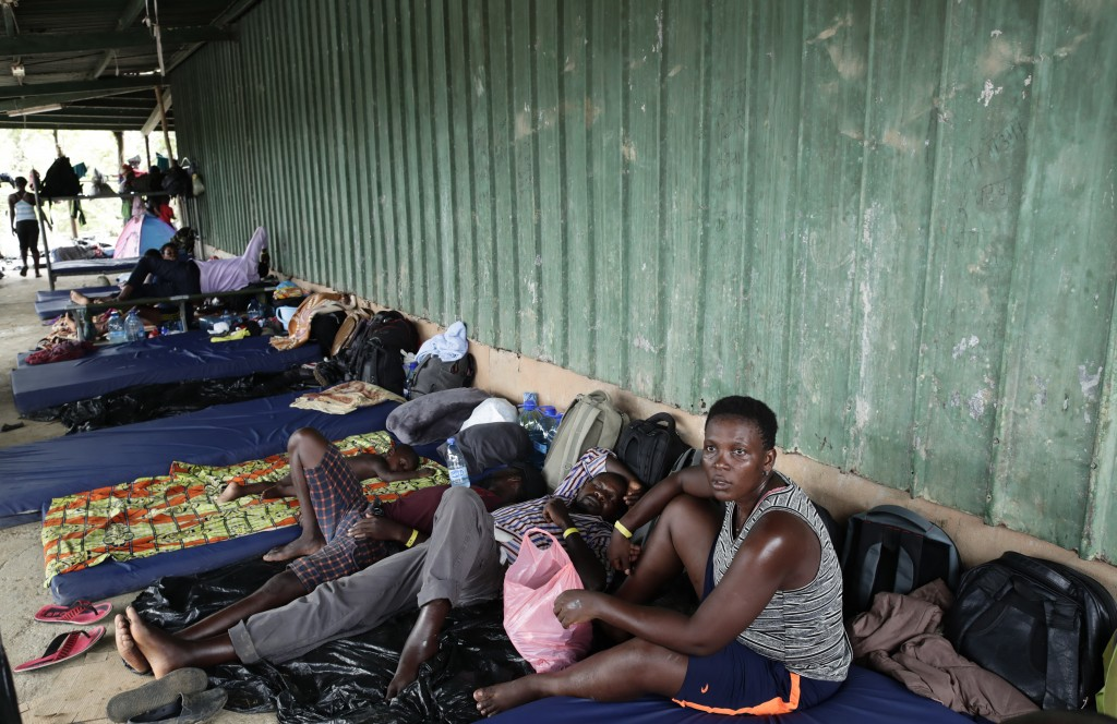 In May 10, 2019 photo, migrants from several African countries rest on mattresses outside a barn used as a shelter in Peñitas, Darien Province, Panama
