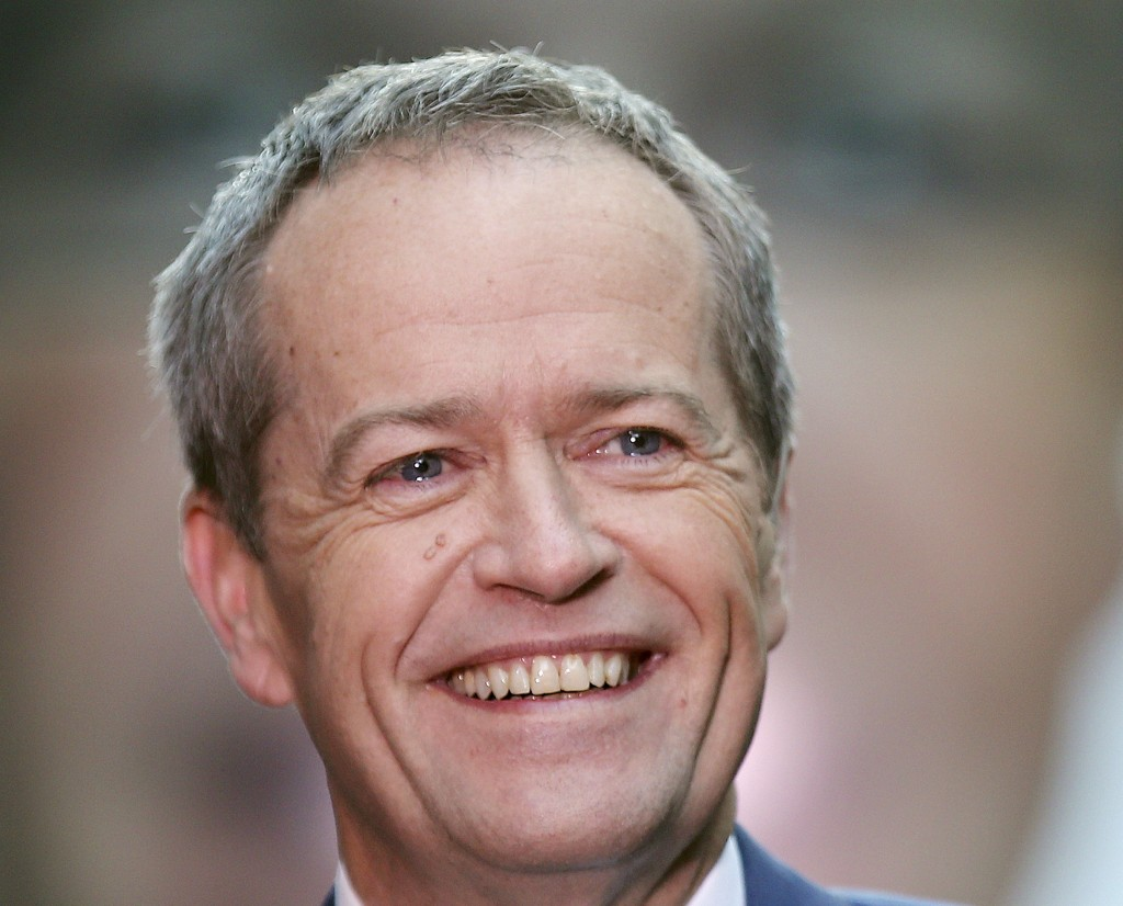 FILE - In this July 2, 2016, file photo, Australian Labor Party leader Bill Shorten speaks to supporters on a street after a breakfast show television