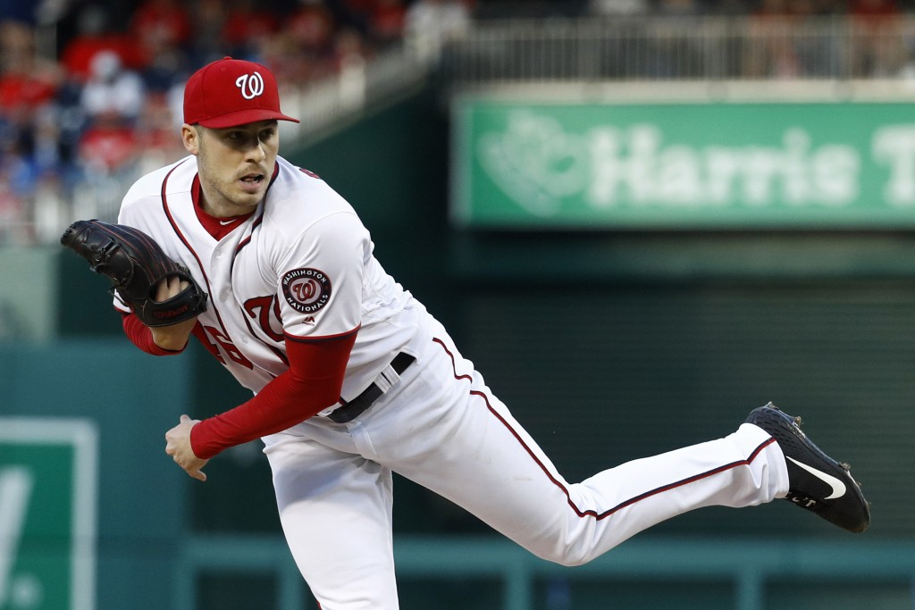 Washington Nationals starting pitcher Patrick Corbin follows through on a pitch to the New York Mets in the second inning of a baseball game, Wednesda...