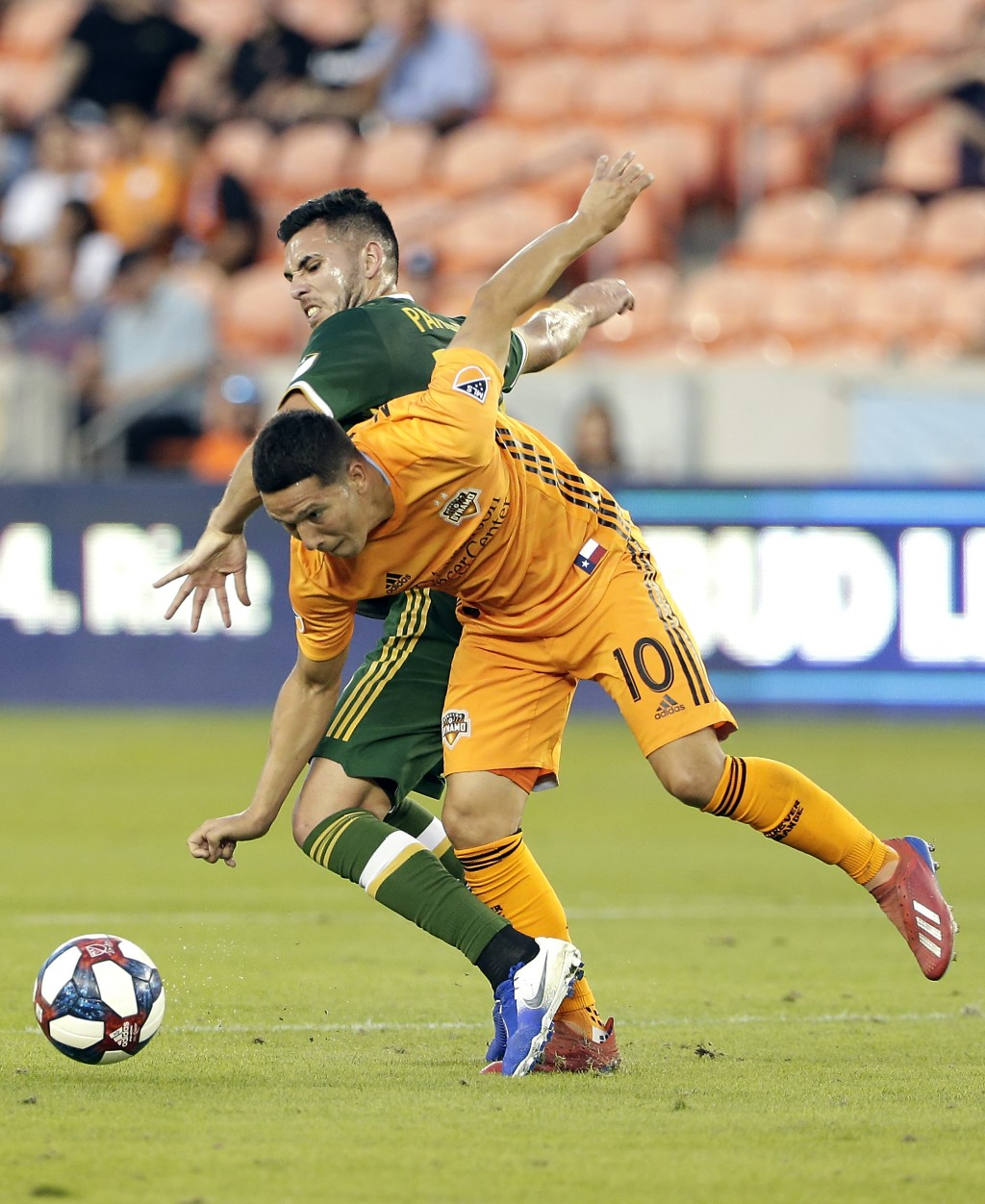 Portland Timbers midfielder Cristhian Paredes, left, and Houston Dynamo midfielder Tomas Martinez (10) battle for control of the ball during the first