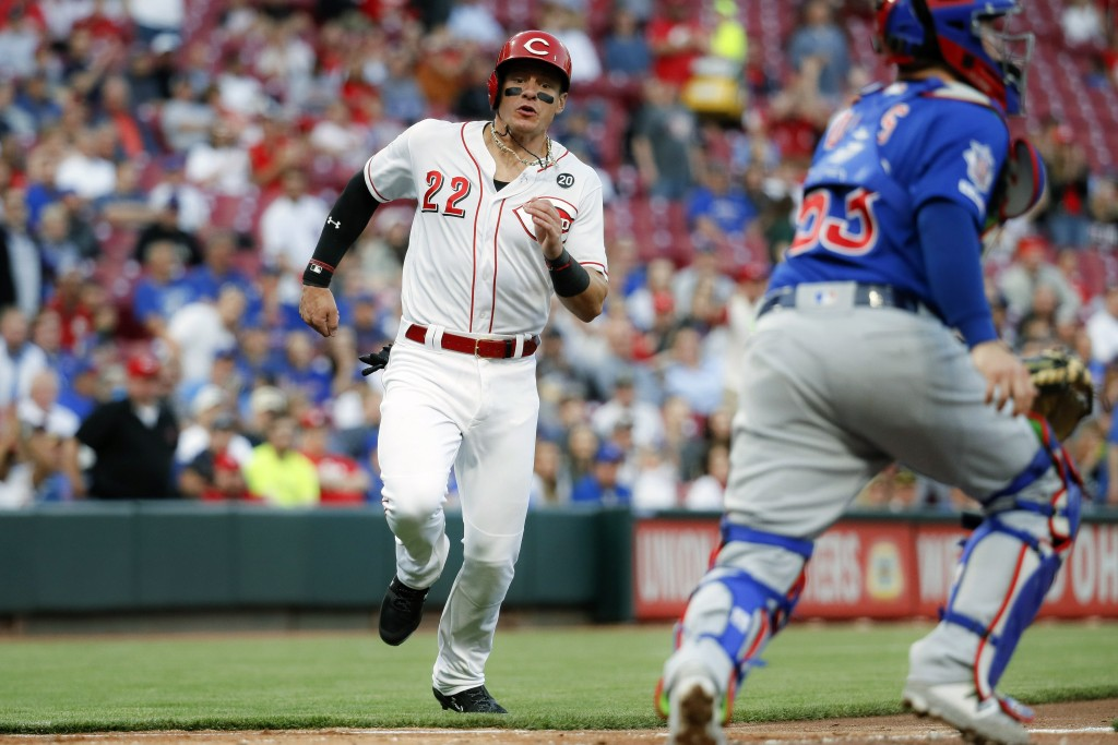 Cincinnati Reds' Derek Dietrich (22) runs how to score on a RBI double by Jose Iglesias off Chicago Cubs starting pitcher Yu Darvish in the fourth inn