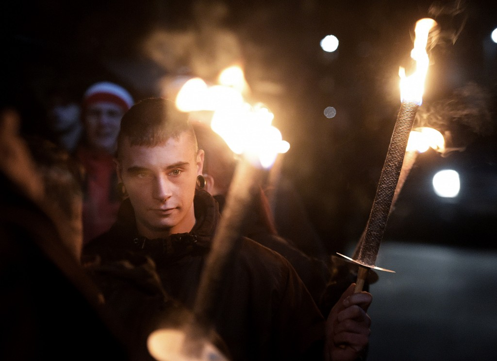 FILE - In this Wednesday, Nov. 9, 2016 file photo, demonstrators hold torches during a far-right Thuegida rally in Jena, Germany. Young voters tend to