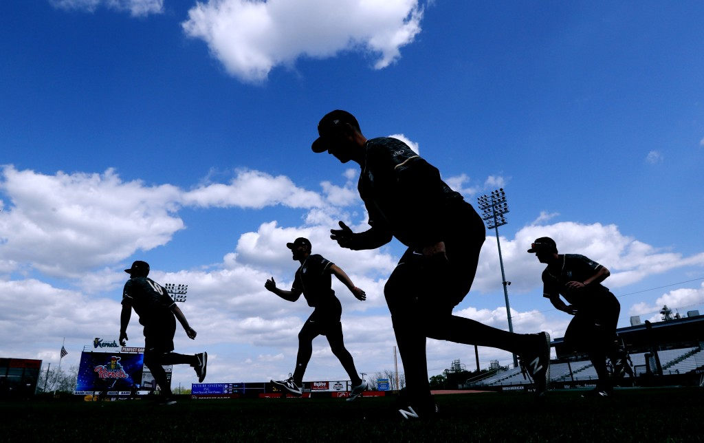 In this Monday, May 13, 2019 photo, Quad Cities River Bandits players warm up before a Class-A Midwest League baseball game against the Cedar Rapids K