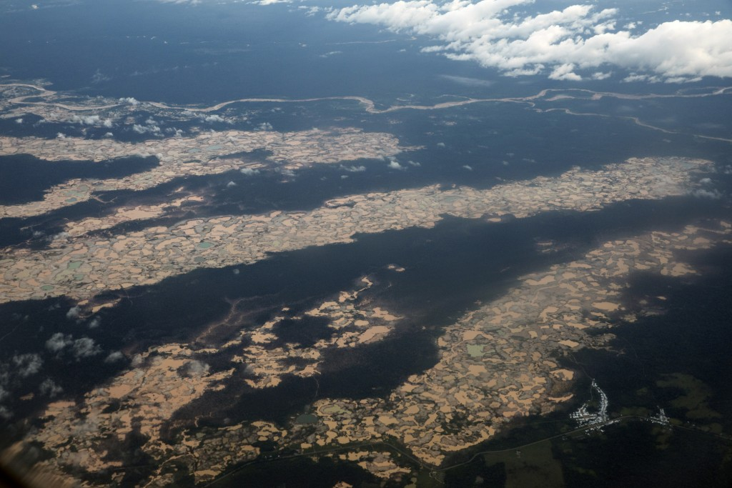 This March 26, 2019 photo shows an aerial view of thousands of destroyed hectares of Amazon jungle by illegal miners, in the Tambopata province, one o...