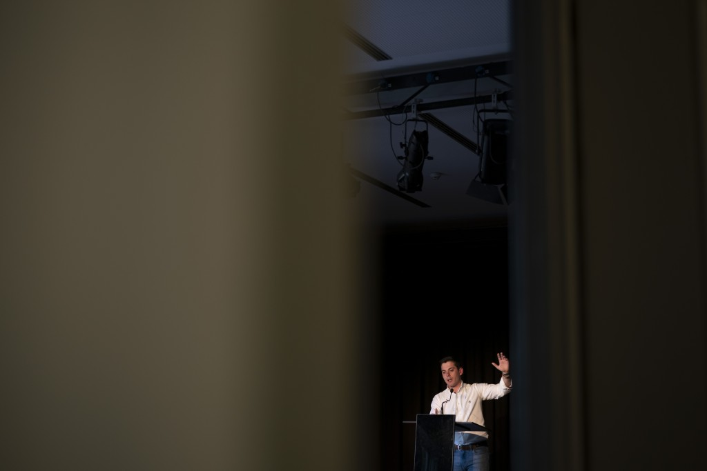 In this May 11, 2019 photo, Luis Felipe Ulecia, 24, far-right Vox party vice secretary for youth, speaks during a meeting for supporters in Barcelona,