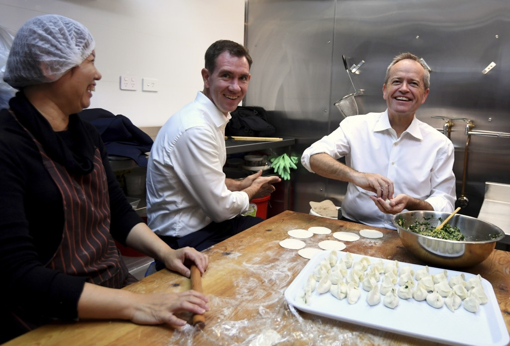 Australian Labour Party leader Bill Shorten, right, and local Labor candidate Sam Crosby, center, make dumplings during a visit to a Chinese restauran